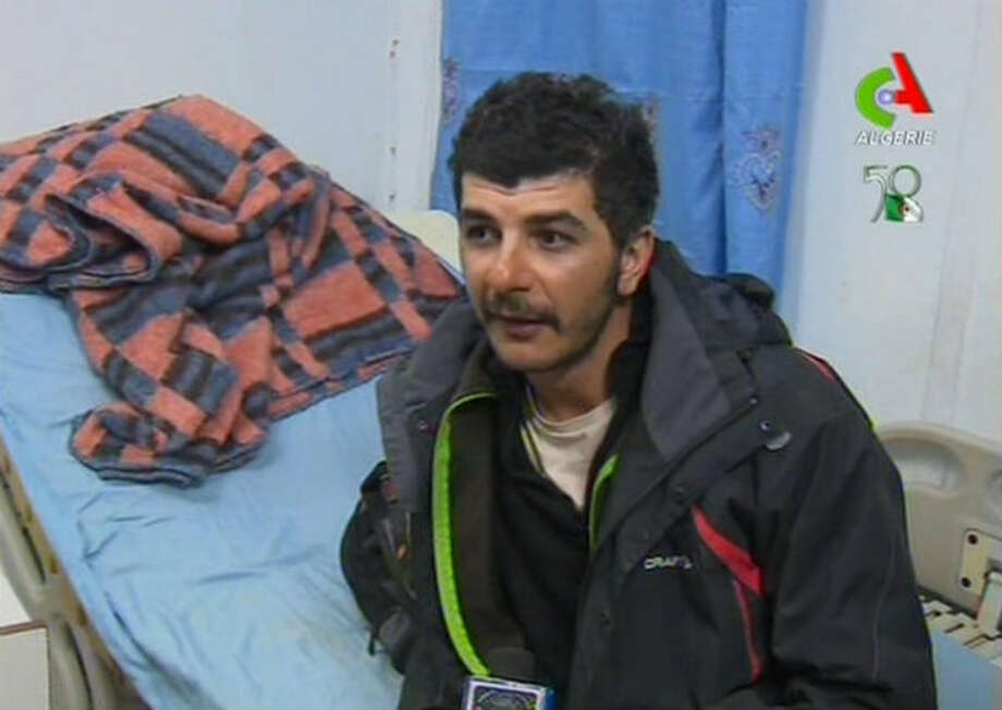An unidentified rescued hostage speaks to the media in a hospital in Ain Amenas, Algeria, in this image taken from television Friday Jan. 18, 2013.