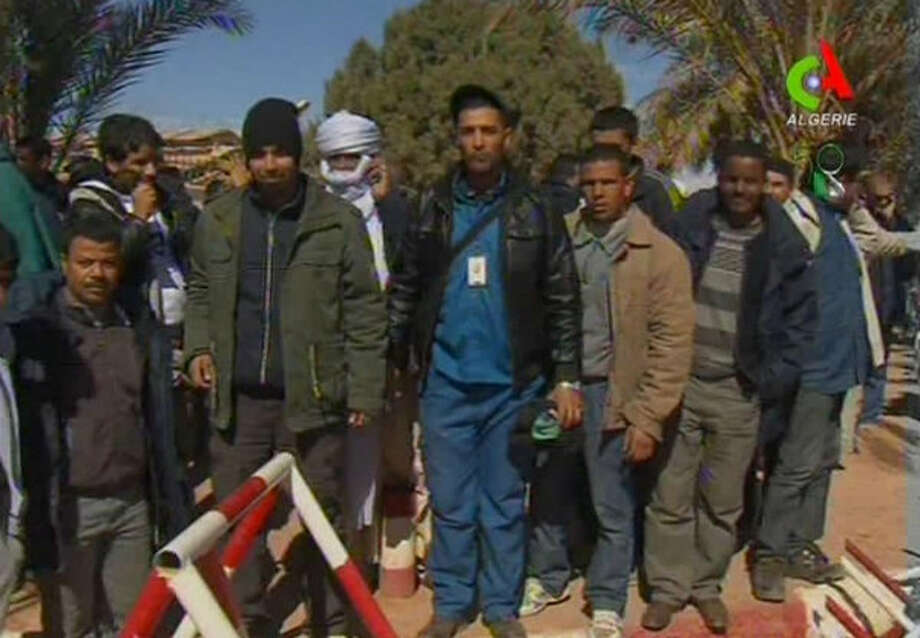 Unidentified rescued hostages pose for the media in Ain Amenas, Algeria, in this image taken from television Friday Jan. 18, 2013.
