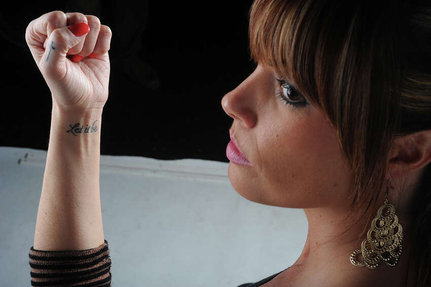 Hollie Toups, 32, said she got 'Let it be' tattooed on her arm after finding her picture on a revenge porn website. Toups was the first woman to join the suit.