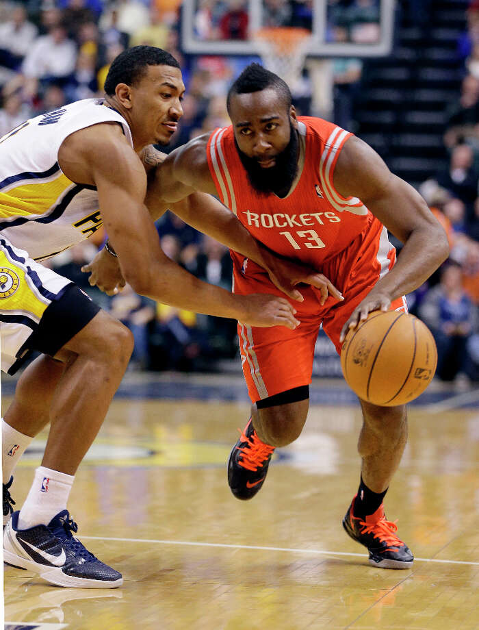 Jan. 18: Pacers 105, Rockets 95Rockets guard James Harden goes to the basket against Orlando Johnson of the Pacers. Photo: Darron Cummings, Associated Press / AP