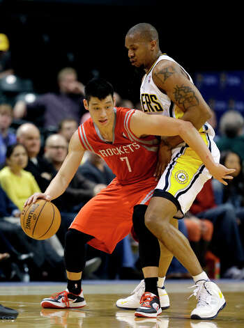 Rockets guard Jeremy Lin tries to get around David West of the Pacers. Photo: Darron Cummings, Associated Press / AP