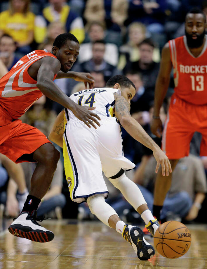 Patrick Beverley of the Rockets strips the basketball from D.J. Augustin of the Pacers. Photo: Darron Cummings, Associated Press / AP