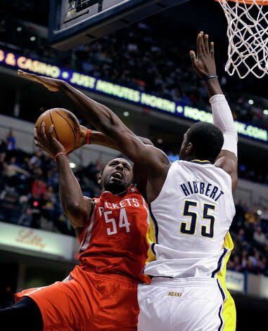 Rockets forward Patrick Patterson puts up a shot against Roy Hibbert of the Pacers. Photo: Darron Cummings, Associated Press / AP