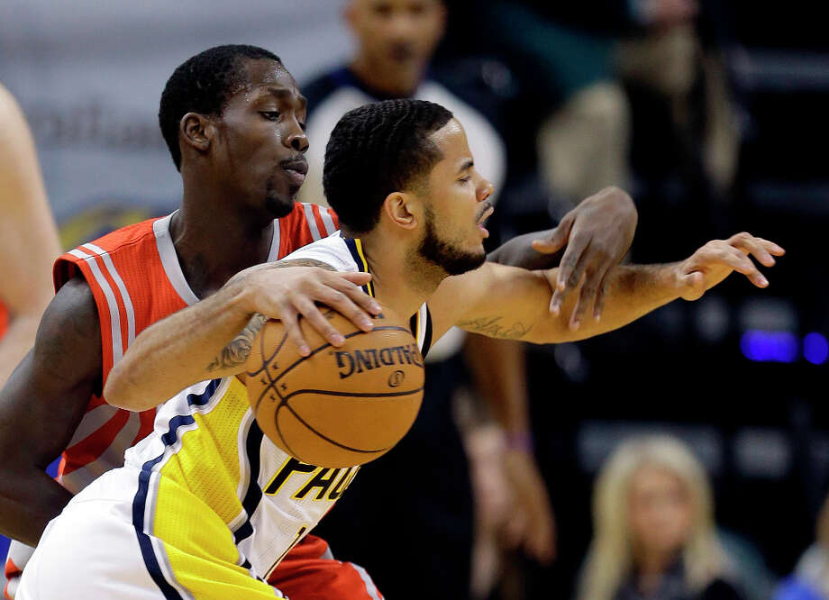 Pacers guard D.J. Augustin is defended by Rockets guard Patrick Beverley. Photo: Darron Cummings, Associated Press / AP