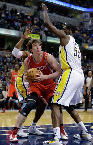 Rockets center Omer Asik tries to shoot over Roy Hibbert of the Pacers. Photo: Darron Cummings, Associated Press / AP