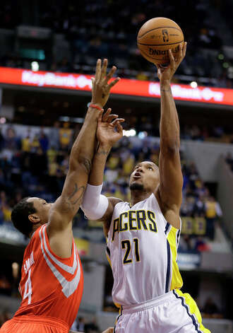 Pacers forward David West attempts a shot over Greg Smith of the Rockets. Photo: Darron Cummings, Associated Press / AP