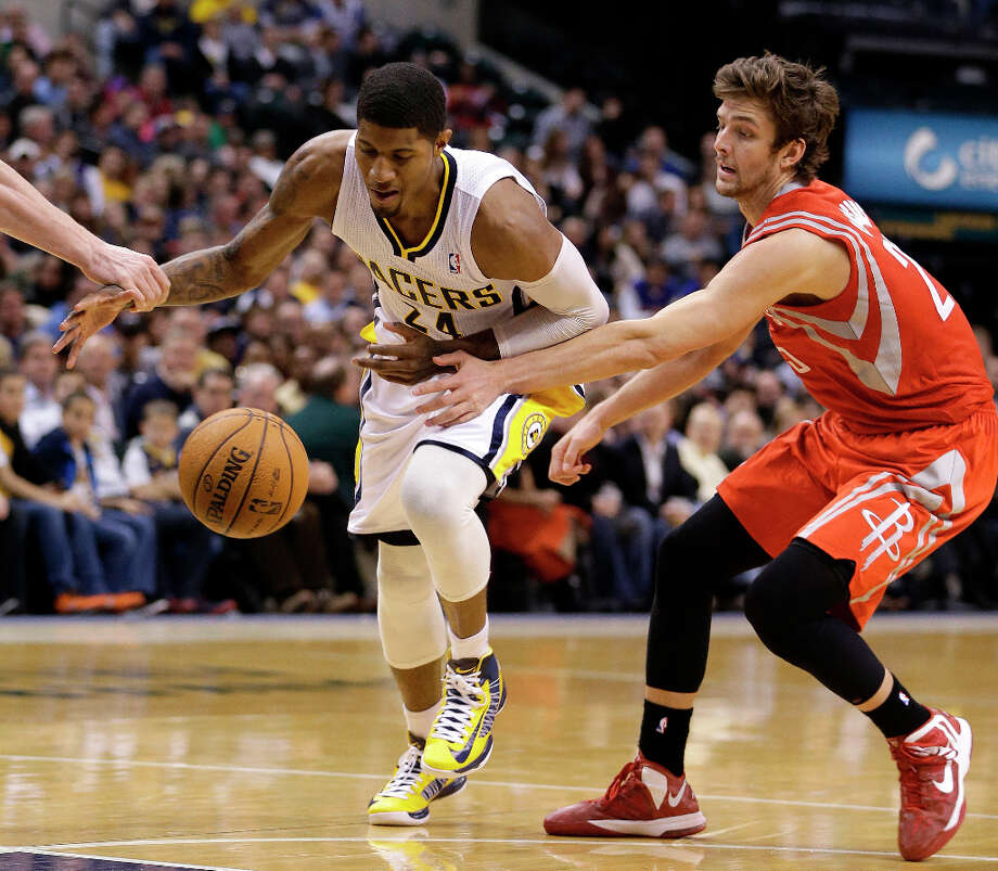 Pacers forward Paul George is defended by Chandler Parsons of the Rockets. Photo: Darron Cummings, Associated Press / AP