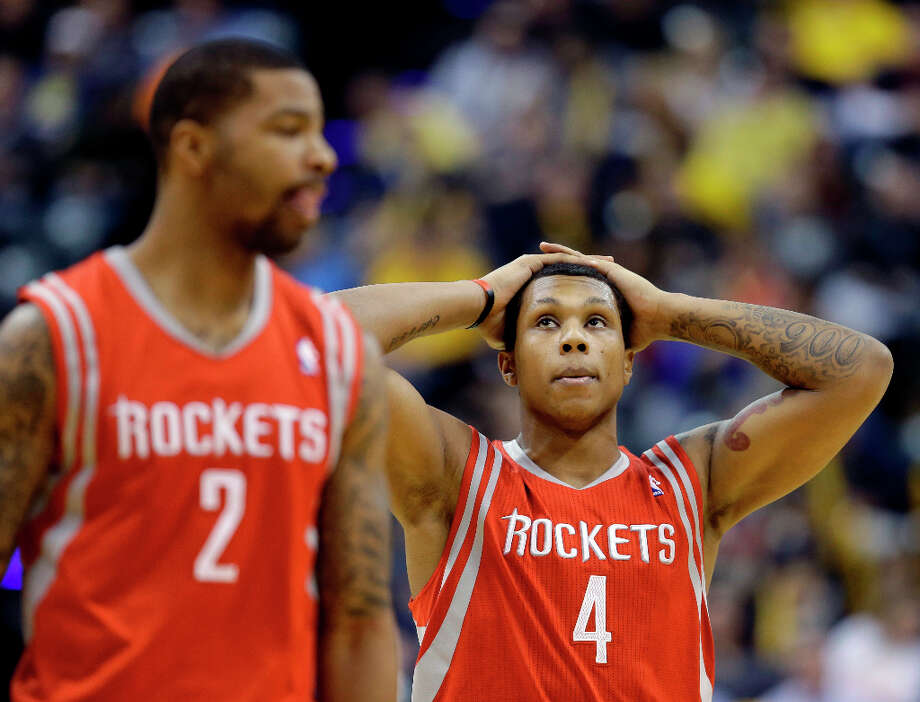 Rockets forward Greg Smith looks up at the scoreboard during a timeout. Photo: Darron Cummings, Associated Press / AP