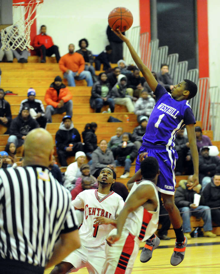 Westhill's Jeremiah Livington takes the ball up to the basket, during boys basketball action against Central in Bridgeport, Conn. on Friday January 18, 2013. Photo: Christian Abraham / Connecticut Post