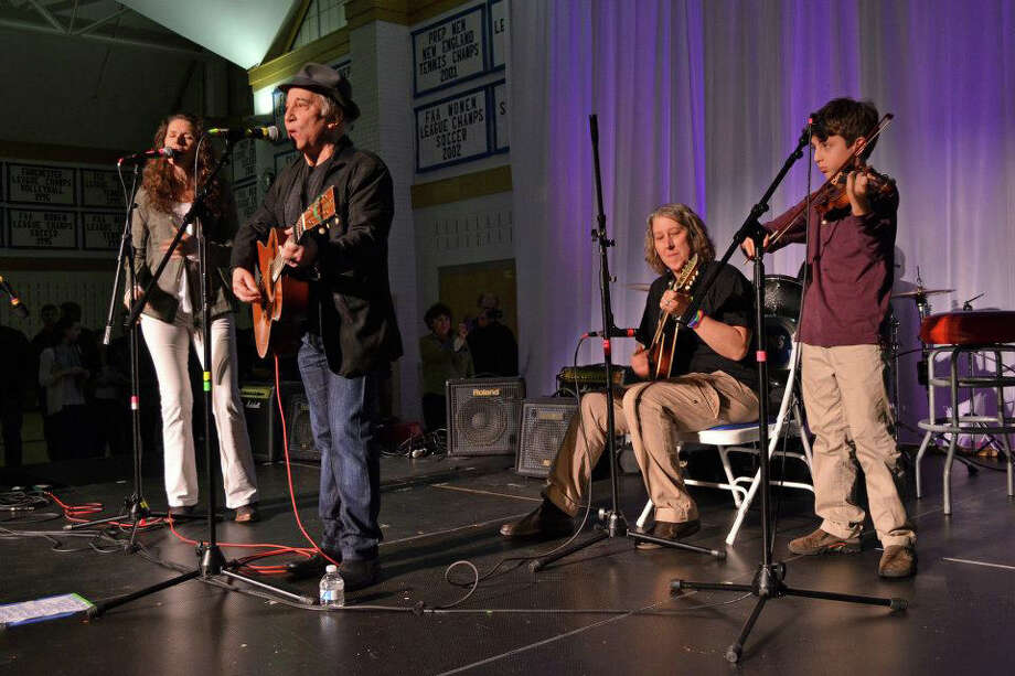 From left, Edie Brickell, Paul Simon, GFA Director of Music Betsy Bergeron and GFA sixth-grader William Shabecoff perform at a concert at Greens Farms Academy in Westport last weekend to benefit The Sandy Hook Support Fund. Photo: Contributed Photo