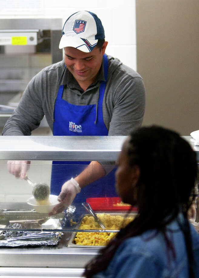 Juan Sorto is a regular on the breakfast line at the Star of Hope Women and Family Emergency Shelter in Houston. While in the nation's capital this week, he'll also feed the homeless. Photo: Cody Duty, Staff / © 2012 Houston Chronicle