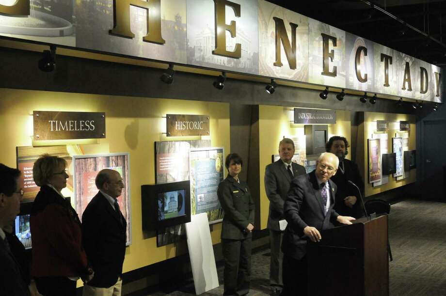 Congressman Paul Tonko, right, congratulates Capital Region organizations that won grants from the Erie Canalway National Heritage Corridor to boost Erie Canal education, preservation, and tourism during a press conference at Proctors Theater Friday Jan.18,2013 in Schenectady, N.Y. (Michael P. Farrell/Times Union) Photo: Michael P. Farrell