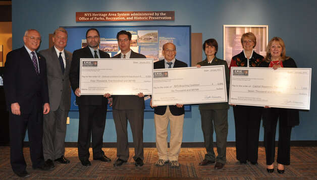Capital Region grant recipients accept their big checks from the Erie Canalway National Heritage Corridor at Proctor in Schenectady. (Courtesy Erie Canalway National Heritage Corridor)