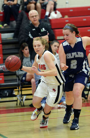 New Canaan's Elizabeth Miller (13) controls the ball as Staples' Maggie Fair (2) defends during the girls basketball game at New Canaan High School on Friday, Jan. 18, 2013. Photo: Amy Mortensen / Connecticut Post Freelance