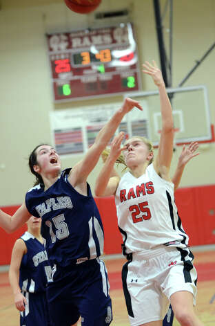 New Canaan's Kelly Armstrong (25) goes up for a shot as Staples' Madeline Schemel (15) defends during the girls basketball game at New Canaan High School on Friday, Jan. 18, 2013. Photo: Amy Mortensen / Connecticut Post Freelance