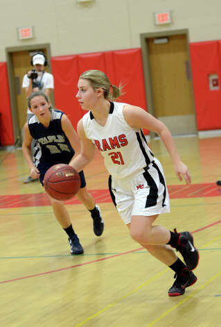 New Canaan's Courtney Rogers (21) controls the ball during the girls basketball game against Staples at New Canaan High School on Friday, Jan. 18, 2013. Photo: Amy Mortensen / Connecticut Post Freelance