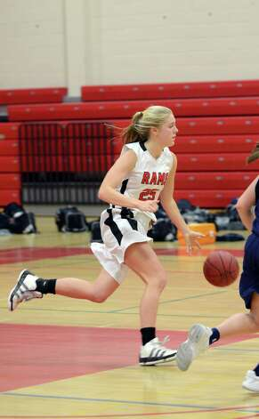 New Canaan's Kelly Armstrong (25) controls the ball during the girls basketball game against Staples at New Canaan High School on Friday, Jan. 18, 2013. Photo: Amy Mortensen / Connecticut Post Freelance