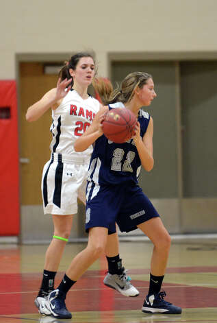 Staples' Nikki Bukovsky (22) controls the ball as New Canaan's Brianna McEwan (20) defends during the girls basketball game at New Canaan High School on Friday, Jan. 18, 2013. Photo: Amy Mortensen / Connecticut Post Freelance