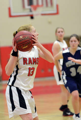 New Canaan's Elizabeth Miller (13) controls the ball during the girls basketball game against Staples at New Canaan High School on Friday, Jan. 18, 2013. Photo: Amy Mortensen / Connecticut Post Freelance