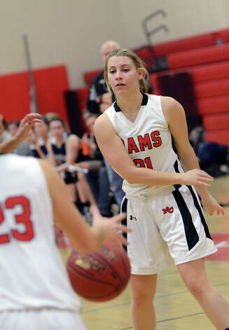 New Canaan's Courtney Rogers (21) passes the ball to a teammate during the girls basketball game against Staples at New Canaan High School on Friday, Jan. 18, 2013. Photo: Amy Mortensen / Connecticut Post Freelance