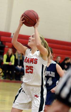 New Canaan's Kelly Armstrong (25) prepares to shoot during the girls basketball game against Staples at New Canaan High School on Friday, Jan. 18, 2013. Photo: Amy Mortensen / Connecticut Post Freelance