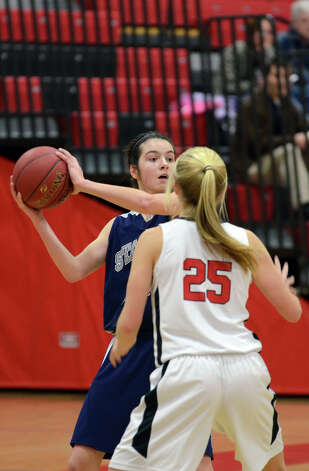 Staples' Madeline Schemel (15) looks to pass as New Canaan's Kelly Armstrong (25) defends during the girls basketball game at New Canaan High School on Friday, Jan. 18, 2013. Photo: Amy Mortensen / Connecticut Post Freelance