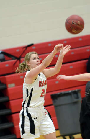 New Canaan's Courtney Rogers (21) shoots during the girls basketball game against Staples at New Canaan High School on Friday, Jan. 18, 2013. Photo: Amy Mortensen / Connecticut Post Freelance