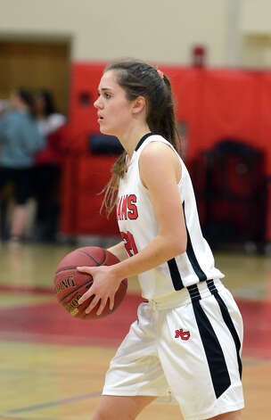 New Canaan's Brianna McEwan (20) controls the ball during the girls basketball game against Staples at New Canaan High School on Friday, Jan. 18, 2013. Photo: Amy Mortensen / Connecticut Post Freelance