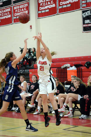 New Canaan's Courtney Rogers (21) takes a shot during the girls basketball game against Staples at New Canaan High School on Friday, Jan. 18, 2013. Photo: Amy Mortensen / Connecticut Post Freelance