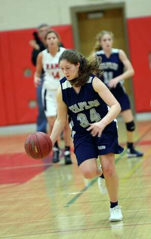 Staples' Erica Stein (34) controls the ball during the girls basketball game against New Canaan at New Canaan High School on Friday, Jan. 18, 2013. Photo: Amy Mortensen / Connecticut Post Freelance