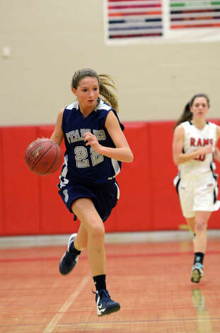 Staples' Nikki Bukovsky (22) controls the ball during the girls basketball game against New Canaan at New Canaan High School on Friday, Jan. 18, 2013. Photo: Amy Mortensen / Connecticut Post Freelance