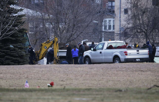 A backhoe is seen at Rosehill Cemetery in Chicago, Friday, Jan. 18, 2013, as workers begin the process of exhuming the body of Urooj Khan who was poisoned with cyanide after winning the lottery. Khan died in July as he was about to collect $425,000 in lottery winnings. His death was initially ruled a result of natural causes, but a relative pressed for a deeper look and his death was reclassified as a homicide.  (AP Photo/M. Spencer Green) Photo: M. Spencer Green