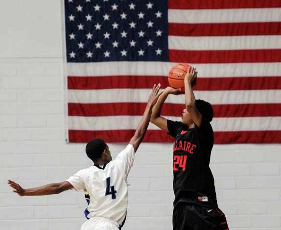 Bellaire's Calvin Dean (24) shoots a jumper as Westside's Brandon Woods (4) applies pressure during a high school basketball game between Westside and Bellaire at Delmar Fieldhouse, Friday, January 18, 2013. Westside defeated Bellaire 67-62. Photo: Bob Levey, Houston Chronicle / ©2013 Bob Levey