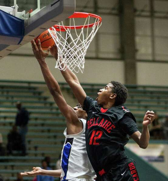 Westside's Robert Hatter, IV has his shot blocked by Bellaire's Christian James (12) during a high s