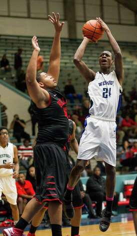 Westside's Rodrick Trimont (24) shoots a short jumper over Bellaire's Charles Sanders (42)during a high school basketball game between Westside and Bellaire at Delmar Fieldhouse, Friday, January 18, 2013. Westside defeated Bellaire 67-62. Photo: Bob Levey, Houston Chronicle / ©2013 Bob Levey