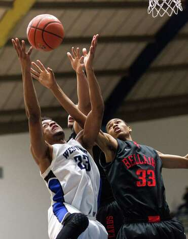 Westside's Franklin Iheanacho (23) grabs a rebound away from Bellaire's Joshua Hall (33) during a high school basketball game between Westside and Bellaire at Delmar Fieldhouse, Friday, January 18, 2013. Westside defeated Bellaire 67-62. Photo: Bob Levey, Houston Chronicle / ©2013 Bob Levey