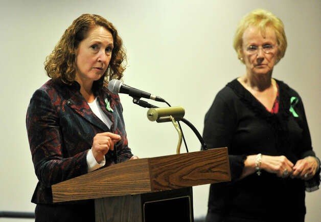 Congresswoman Elizabeth Esty, left, speaks as First Selectman Pat Llodra listens during the community meeting at Newtown High School discussing the fate of Sandy Hook Elementary School on Friday, Jan. 18, 2013. Photo: Jason Rearick / The News-Times