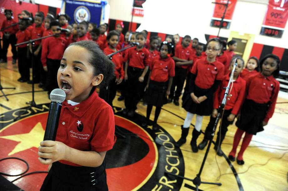 "Anavie Hicks, left,  leads classmates in singing, ""I Celebrate MLK""  during a Remembering and Celebrating Dr. Martin Luther King Jr. program at the Albany Community Charter School on Friday Jan.18,2013 in Albany, N.Y. (Michael P. Farrell/Times Union) Photo: Michael P. Farrell"