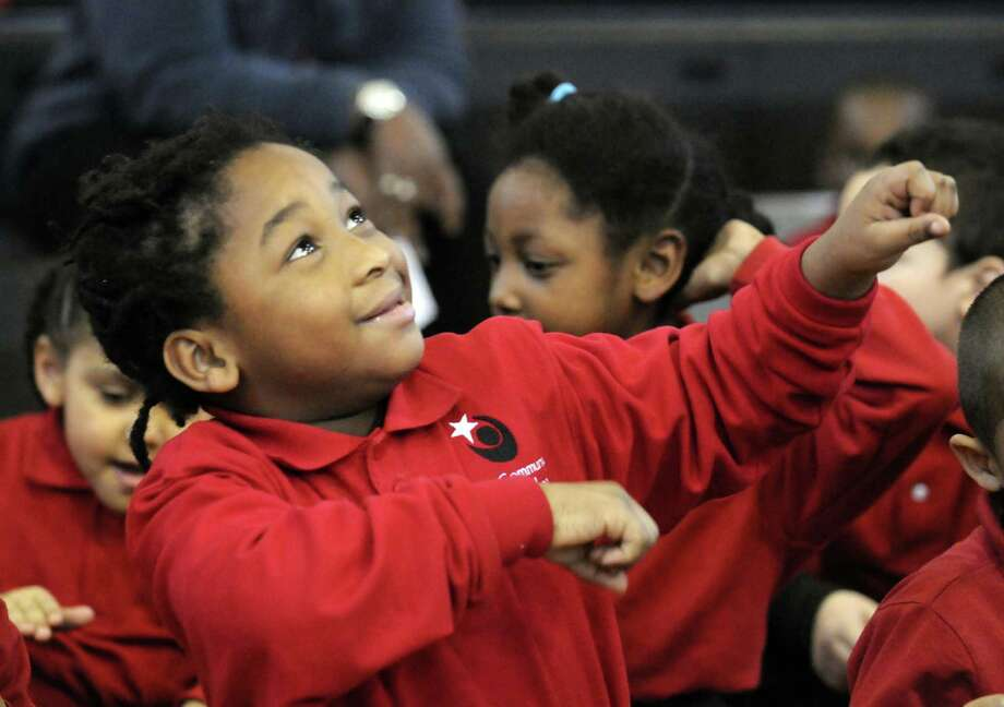 Kindergartener Alondion Johnson groves to the musical selection during a Remembering and Celebrating Dr. Martin Luther King Jr. program at the Albany Community Charter School on Friday Jan.18,2013 in Albany, N.Y. (Michael P. Farrell/Times Union) Photo: Michael P. Farrell