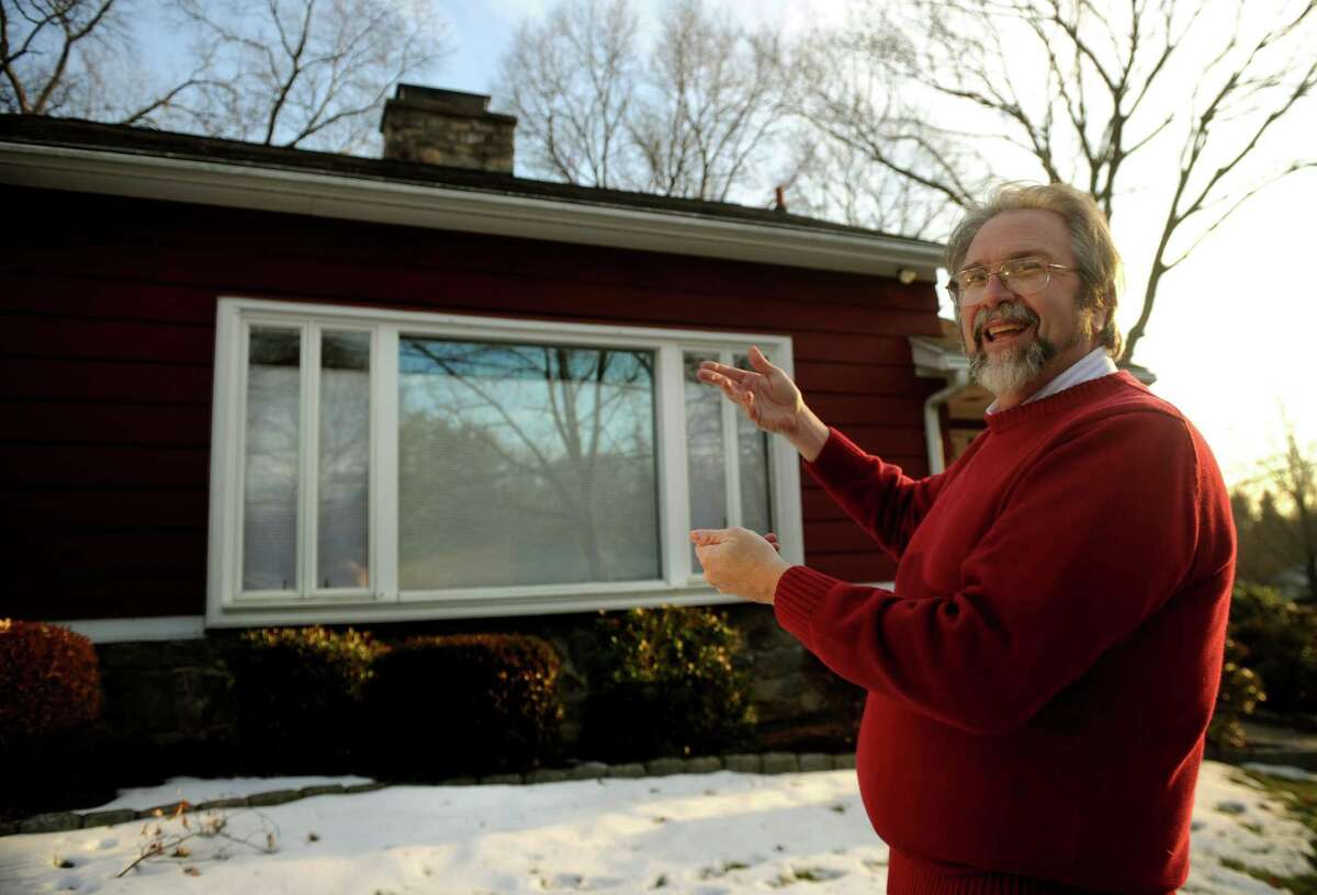 Architect Mark Halstead discusses the Victor Civkin designed Cohn-Lachance house at 93 Mayflower Drive in Bridgeport on Tuesday, January 8, 2013. The home, an example of modernist design, is in the process of receiving historic designation.