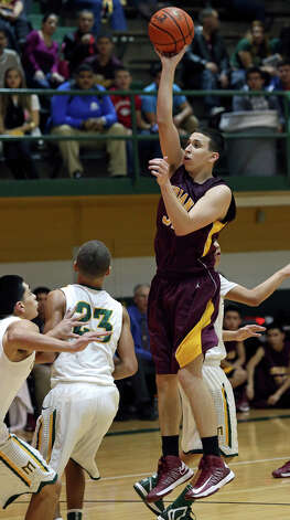 Austin mendez takes to the air for a shot against the Indians as McCollum plays Harlandale in boys basketball at McCollum gym on January 18, 2013. Photo: Tom Reel, Express-News / ©2012 San Antono Express-News