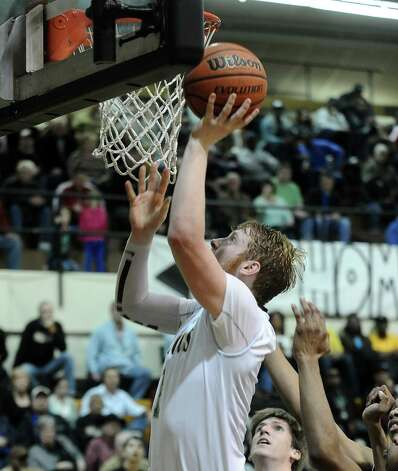 Nederland player Colton Weisbrod, #1, puts it up for two during the Nederland High School boys basketball game against Central High School on Friday, January 18, 2013.  Central won over Nederland 50 - 40. Photo taken: Randy Edwards/The Enterprise