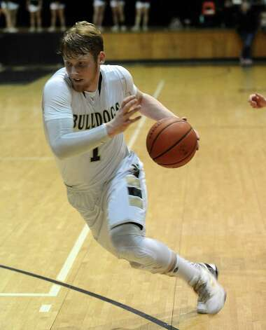 Nederland player Colton Weisbrod, #1, drives to the goal during the Nederland High School boys basketball game against Central High School on Friday, January 18, 2013.  Central won over Nederland 50 - 40. Photo taken: Randy Edwards/The Enterprise
