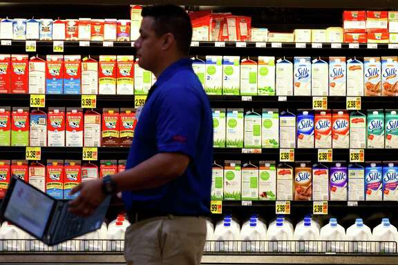 """Various organic and non-dairy milks are available at the Kroger on Studemont. Other grocery chains are also focusing on organic foods. """"We've seen phenomenal growth in natural foods,"""" Kroger Southwest president Bill Breetz says."""