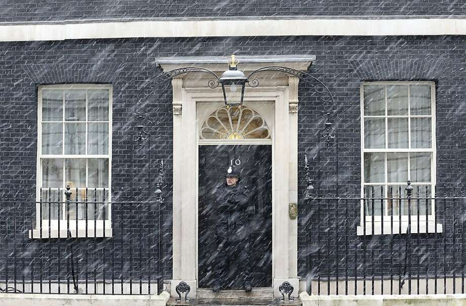 A policeman stands in the driving snow as he guards the front door of 10 Downing Street  in London, on January 18, 2013. Heavy snow is expected to affect large parts of Britain Friday. Photo: Justin Tallis, AFP/Getty Images