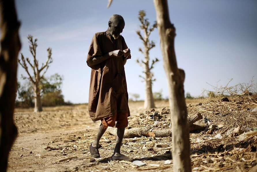 An elderly man walks  in the small village of Ngalamadisi  near Banamba, Mali, some 140 kms (80 mile