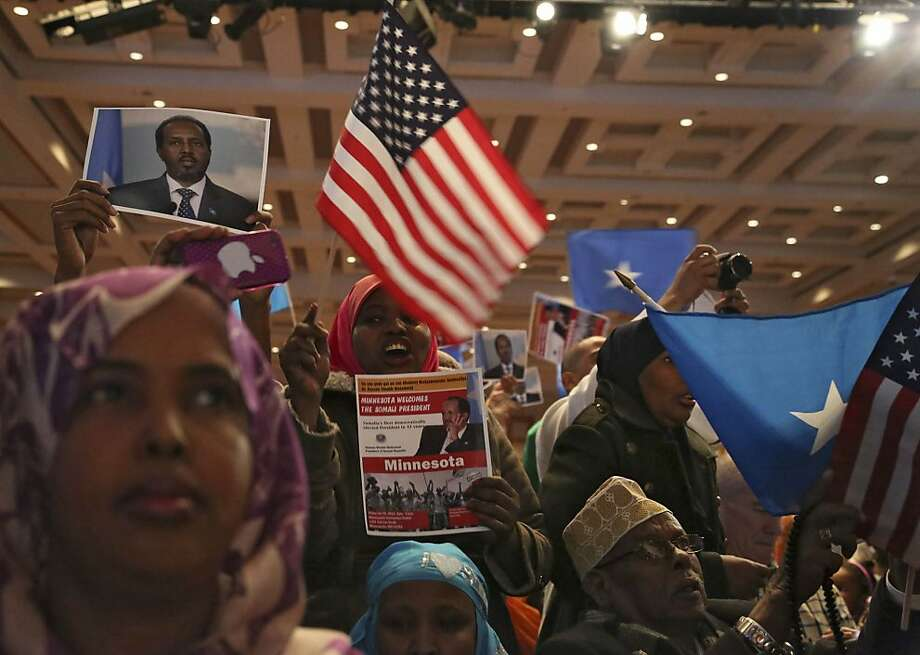 Convention-goers wave flags and and pictures of Somali President Hassan Sheikh Mohamud as hecomes on stage during a Somalia convention at the Minneapolis Convention Center, Minn., Friday Jan. 18, 2013. Minnesota is home to the largest Somali population in the U.S. Photo: Kyndell Harkness, Associated Press