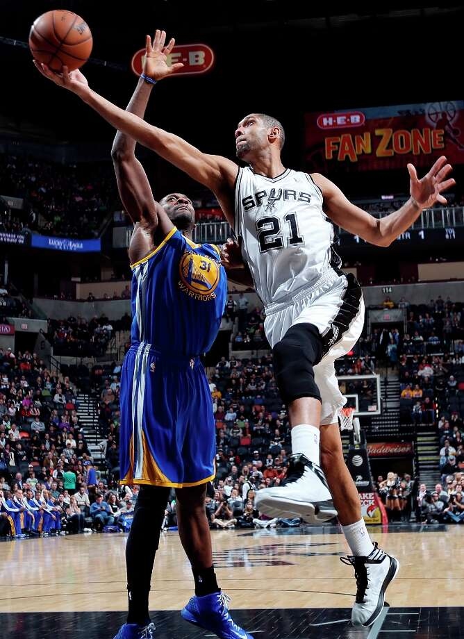 The Spurs' Tim Duncan shoots around Golden State Warriors' Festus Ezeli during first half action Friday Jan. 18, 2013 at the AT&T Center. Photo: Edward A. Ornelas, San Antonio Express-News / © 2012 San Antonio Express-News