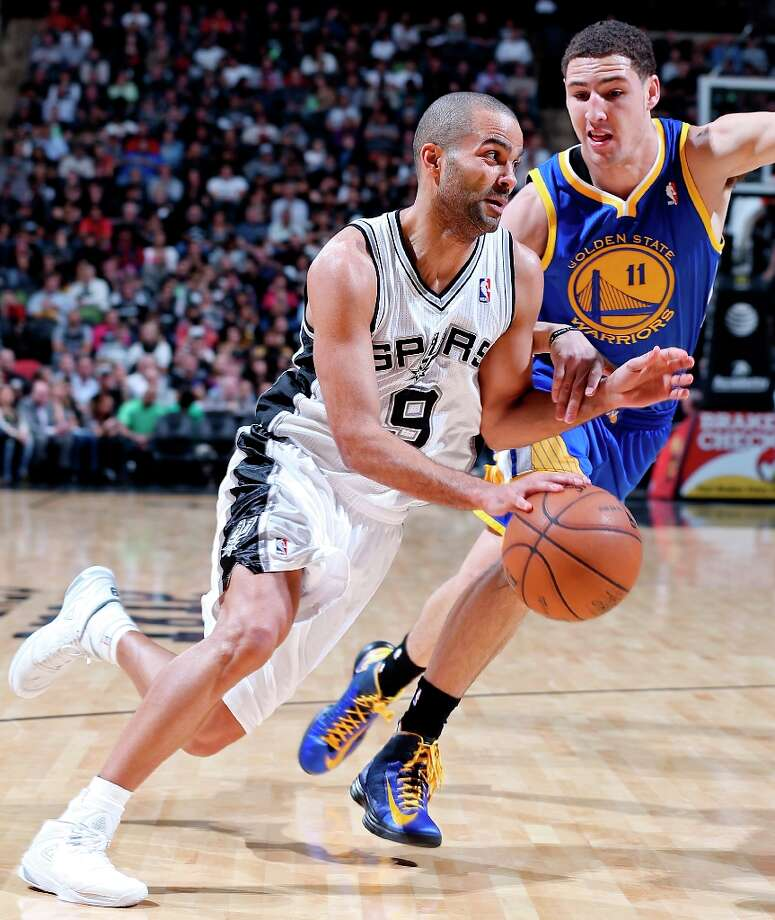 The Spurs' Tony Parker drives around Golden State Warriors' Klay Thompson during second half action Friday Jan. 18, 2013 at the AT&T Center. The Spurs won 95-88. Photo: Edward A. Ornelas, San Antonio Express-News / © 2012 San Antonio Express-News