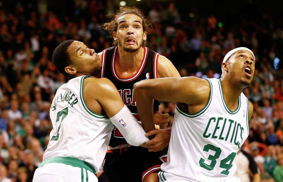 The Celtics' Jared Sullinger (7) and Paul Pierce (34) box out the Bulls' Joakim Noah under the basket during a free-throw attempt. Photo: Jared Wickerham, Staff / 2013 Getty Images